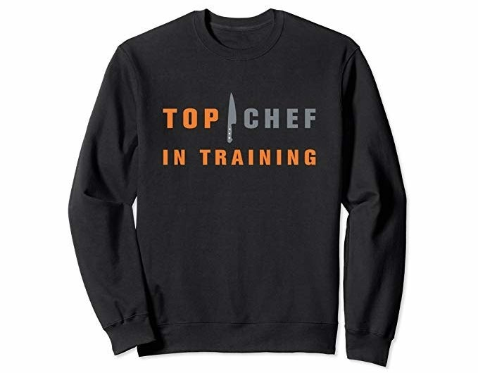 """a long sleeve black tee that says """"top chef in training"""" on it"""