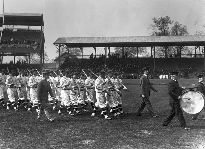 Franklin D. Roosevelt, third from right, walks the Washington Senators out onto the field at Griffith Stadium in Washington, DC, 1917.