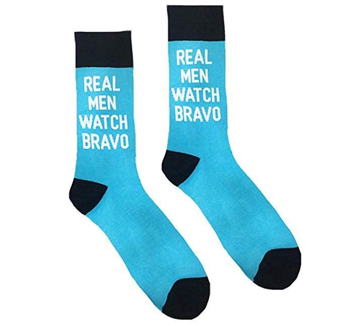 "blue socks that say ""real men watch bravo"""