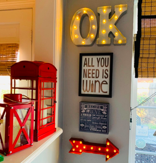 A customer review photo of the marquee letters spelling out OK on their wall.