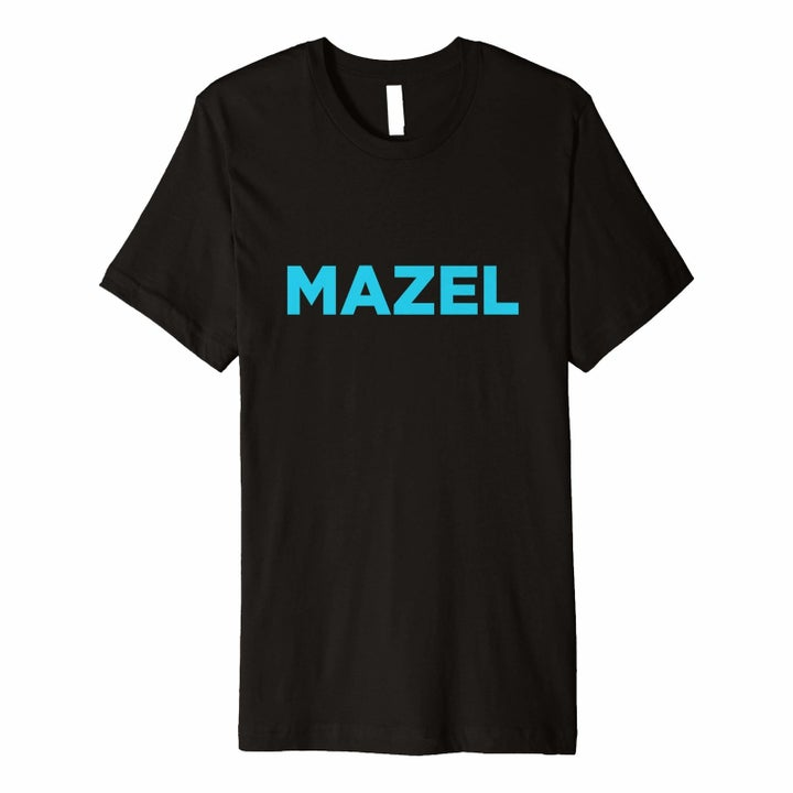 """a black tee that says """"mazel"""" on it in blue"""