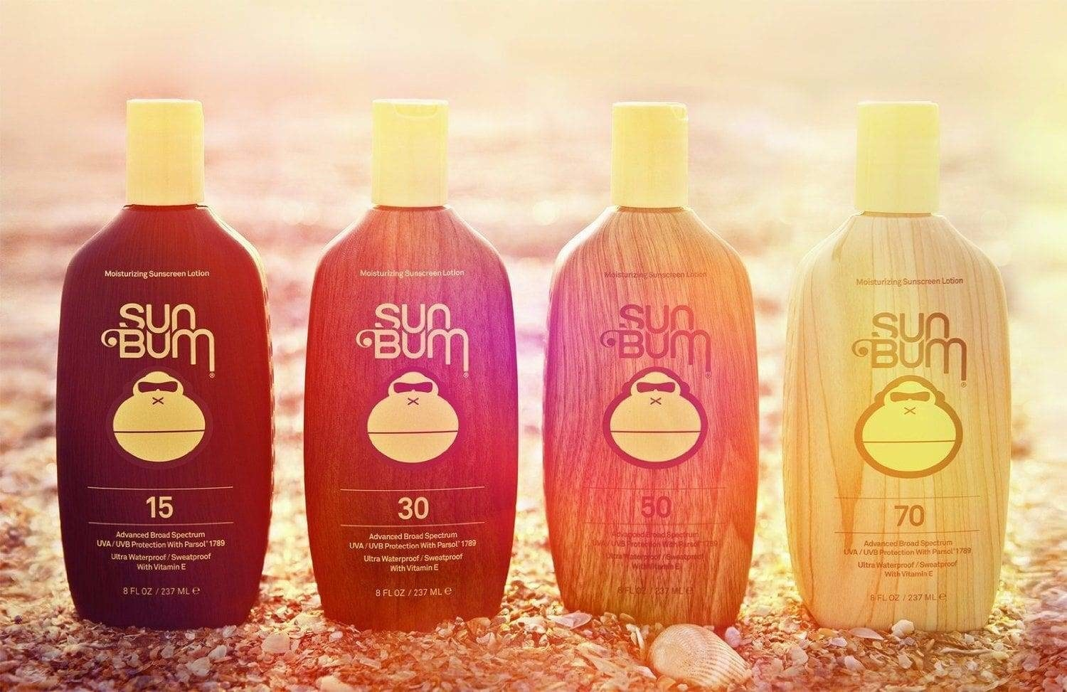 Four bottles of Sun Bum of various SPFs in the sun
