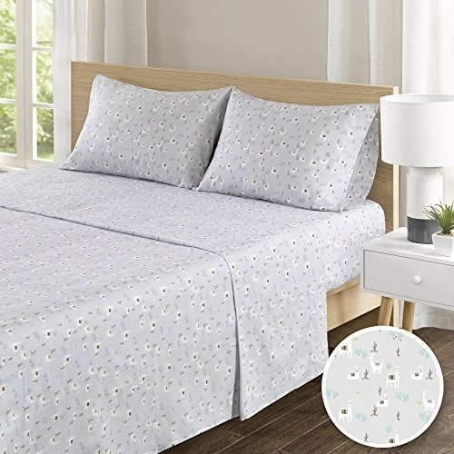 The sheets on a full-size bed in the llama print.