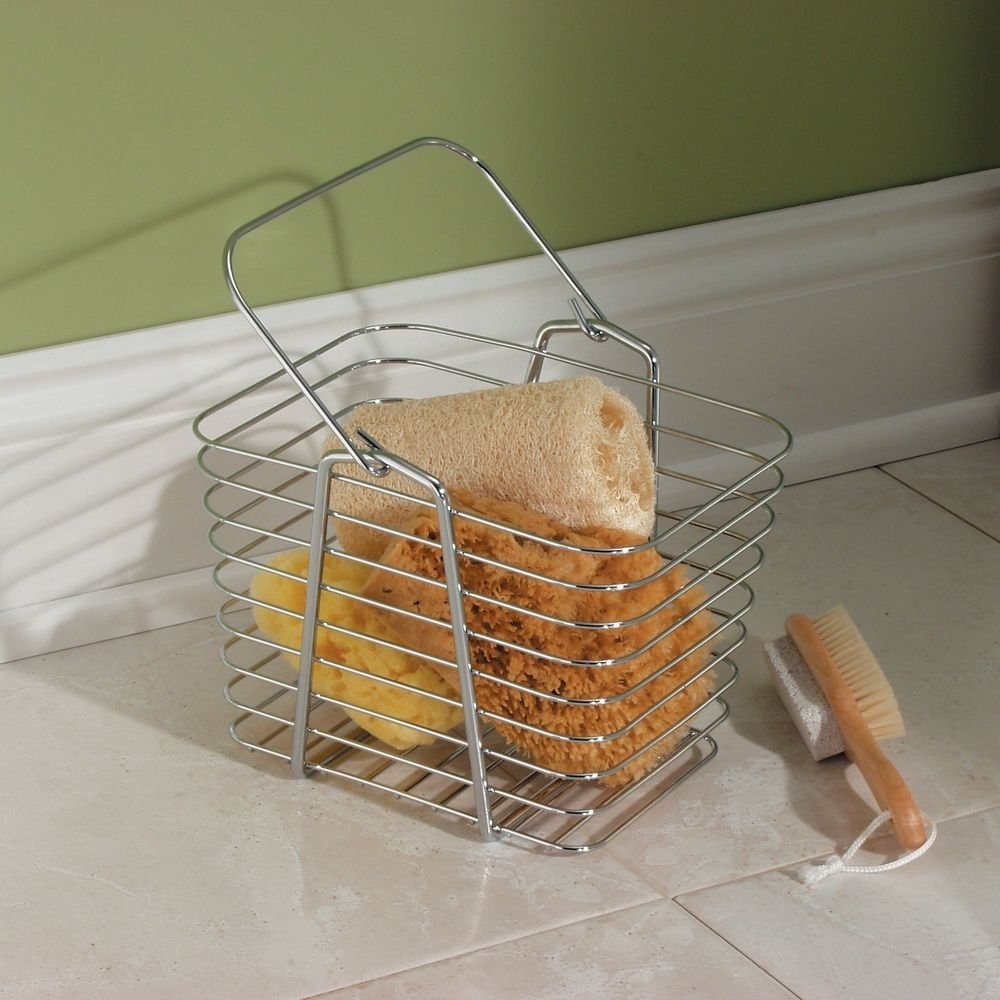 The wire basket holding a variety of shower loofahs.