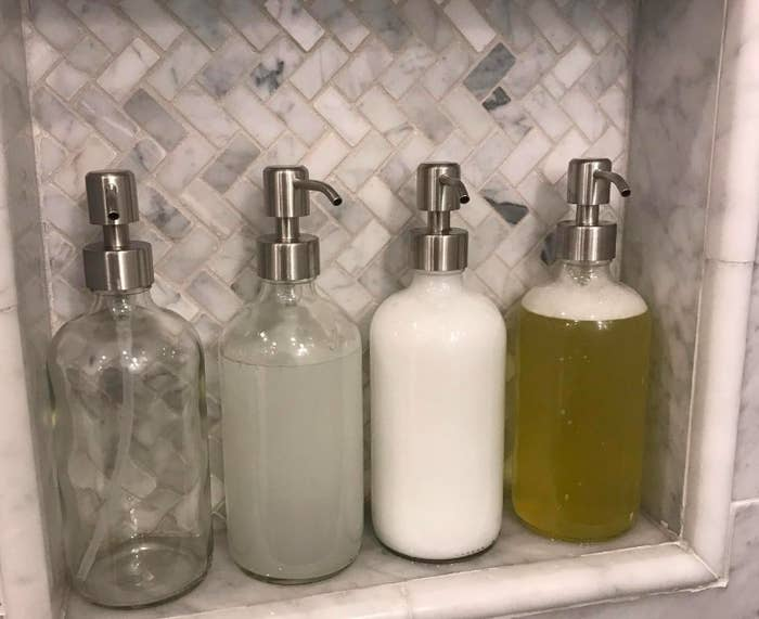 A customer review photo of four soap dispensers in their shower.