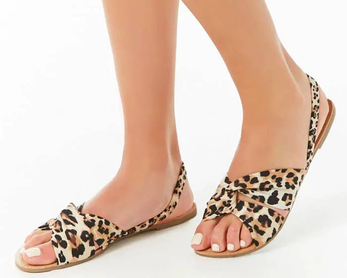 f5d315d61197 A leopard print twisted flat featuring spandex and polyester straps so your  feet stay oh-so comfy as you strut throughout the day.