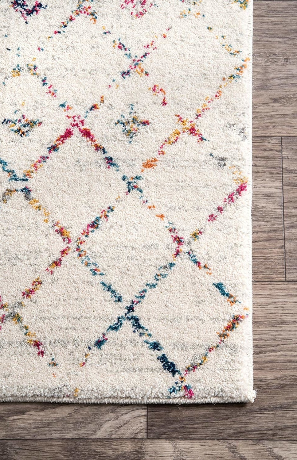 A close up of the corner of the doormat in the light multi.