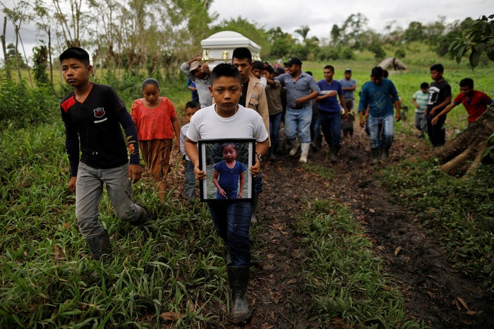Friends and family carry a coffin with the remains of Jakelin Caal, a 7-year-old girl who turned herself in to US border agents earlier this month.