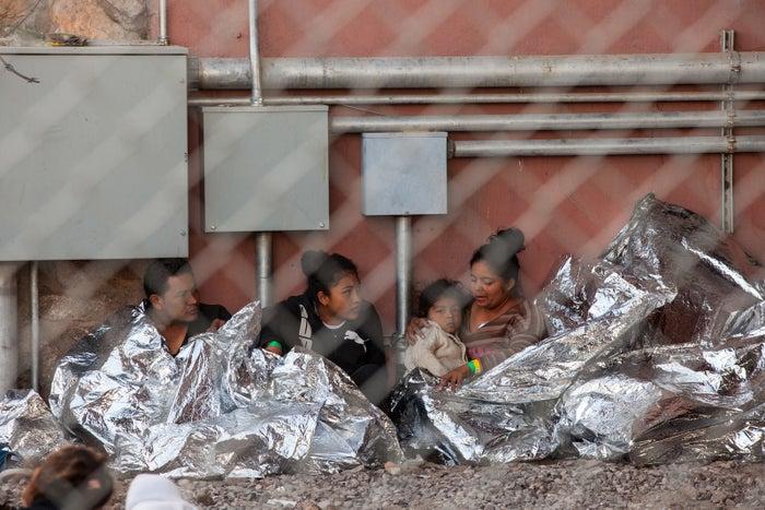Immigrants held in temporary fencing underneath the Paso del Norte Bridge in El Paso, Texas.