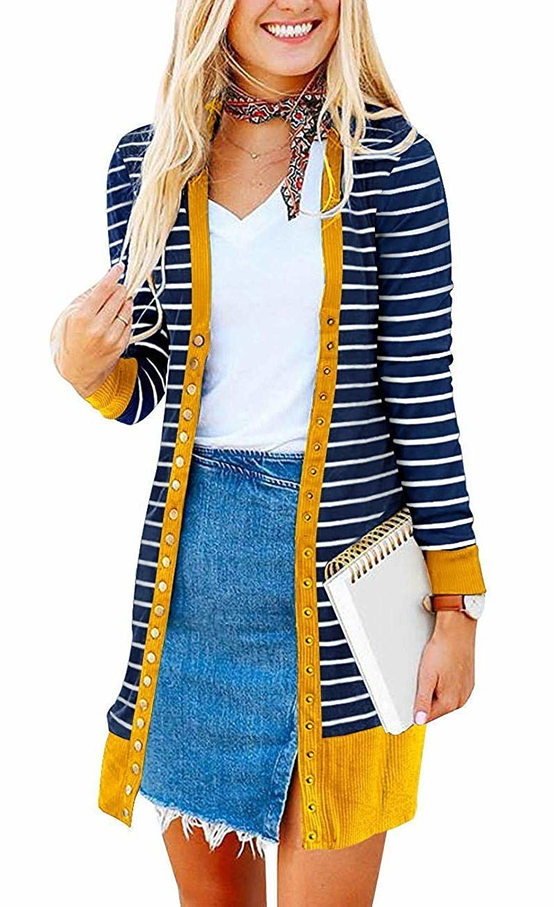 2959bec3f9 A long two-tone striped sweater with snap closures that ll layer perfectly  over jeans or a pair of comfy leggings.