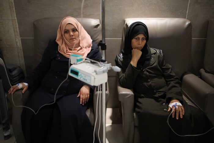 Sanaa Bilbesi and Abla Abu Ajwa, who are both from Gaza, receive chemotherapy in the oncology ward at the Augusta Victoria Hospital in East Jerusalem, Israel.