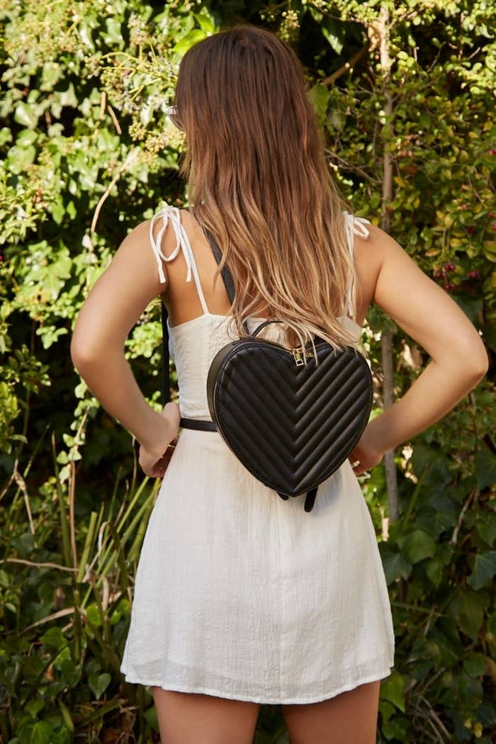d28014e0aef A faux-leather chevron backpack sure to capture your heart. It ll look just  as fancy as a designer version!