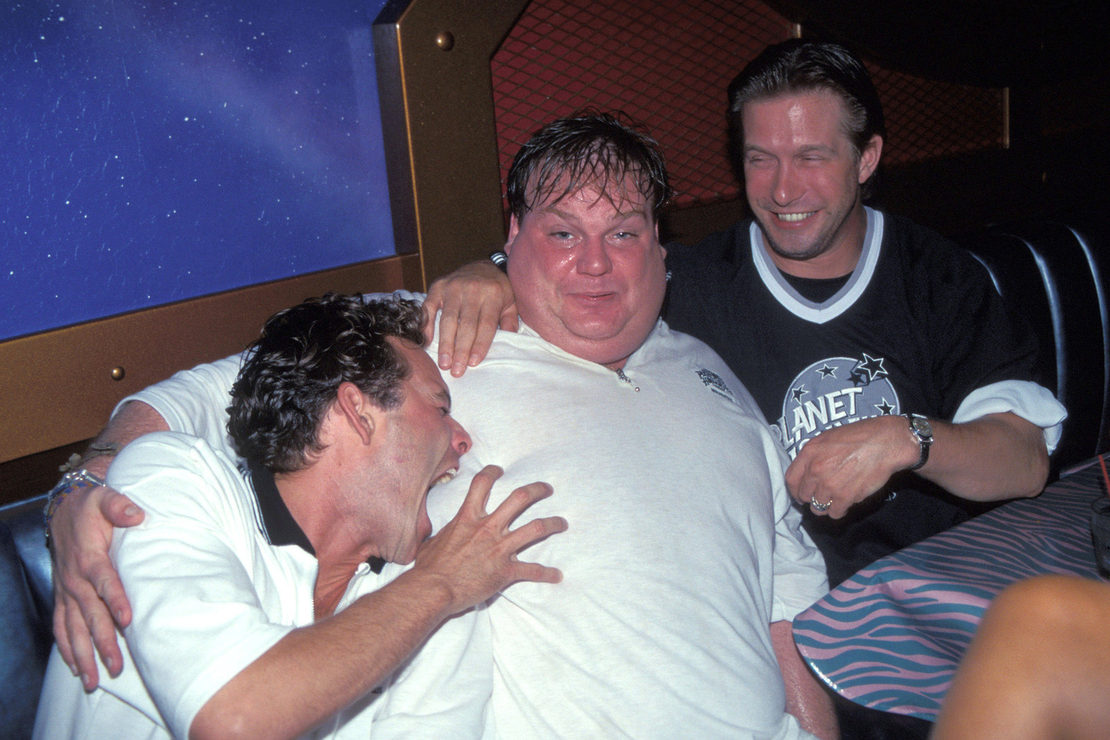 From left, Luke Perry, Chris Farley, and Stephen Baldwin attend a Planet Hollywood event in New York City on June 12, 2002.