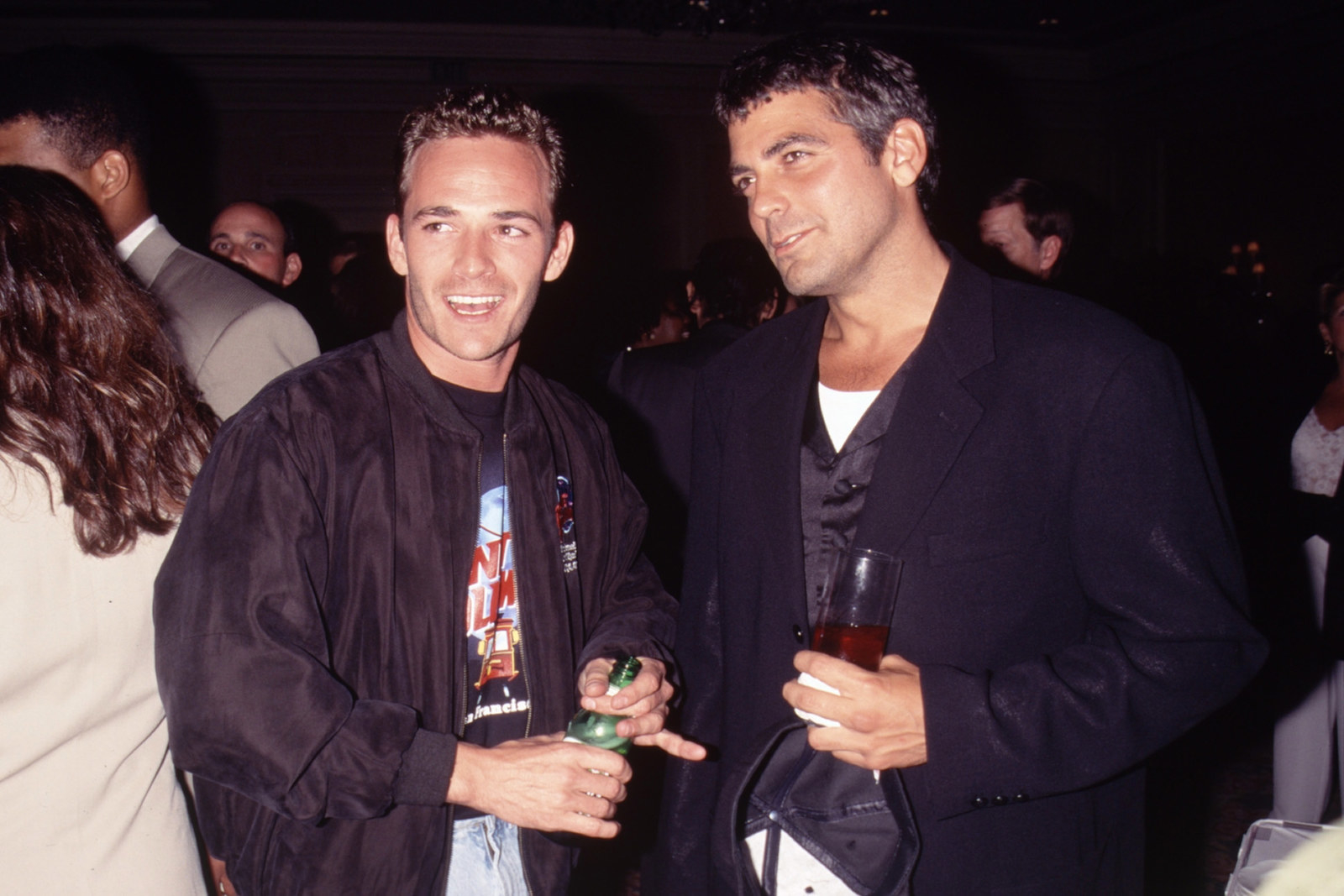 Luke Perry meets George Clooney at a charity event, circa 1990.