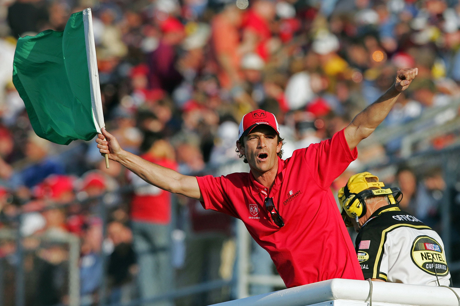 Luke Perry waves the green flag before the start of the NASCAR Nextel Cup Series Dodge Charger 500 on May 13, 2006, at Darlington Raceway in Darlington, South Carolina.