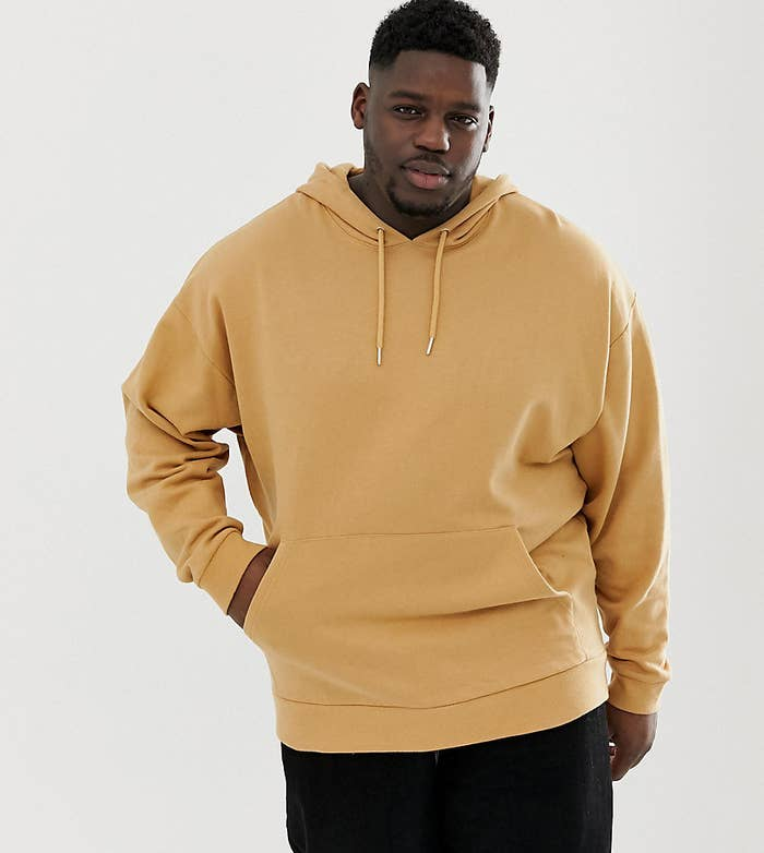 33038cbfbc2dd A men's oversized beige hoodie for a simple but fashionable design you can  wear no matter where you're going.