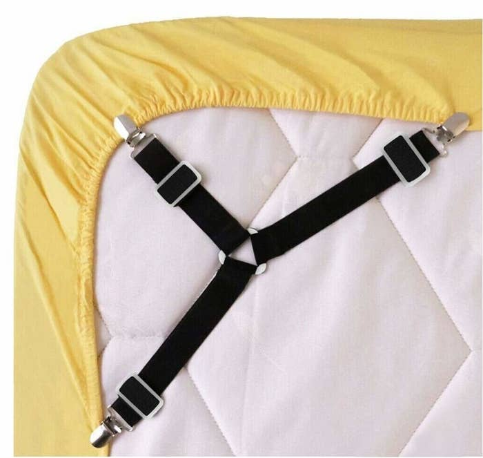 """Promising review: """"I hate a messed up bed. But these clips are amazing. By flipping the fitted corners of the sheet up onto the top of the bed, applying the clips there, and THEN pulling everything back under the mattress, you can fasten these clips quickly and easily. Once the clips are on, flip the fitted corner back down over the mattress and look at the great result. All of the excess fabric vanishes completely. I was expecting some kind of big pucker even while the sheets stayed in place, but there was nothing but tight, smooth fabric."""" —Steven P. GrayGet it from Amazon for $8.99+ (available in two sizes and two colors).And to find out where to buy the best bedding possible, click here."""