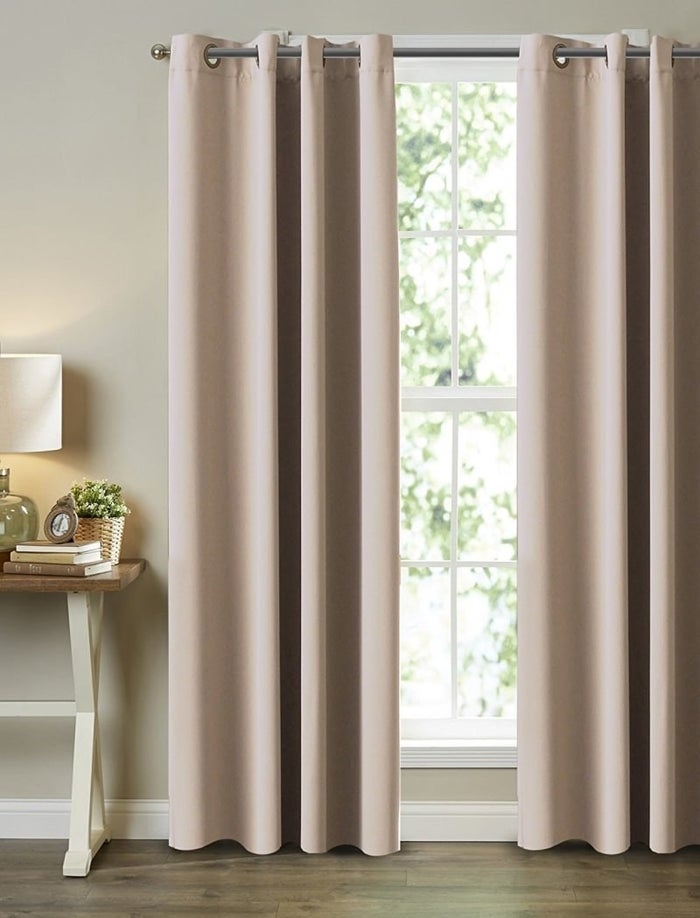 "Promising review: ""When I got this I was so pleased! After hanging what I bought, I got right back on Amazon and hit buy again! Love, love, love them! The drapes themselves are really heavy and well made. It absolutely made that room much cooler, and kept it dark so the sun didn't wake them up at 6 a.m."" —Jan A.Get it from Amazon for $35.99+ (available in five sizes and 17 colors)."