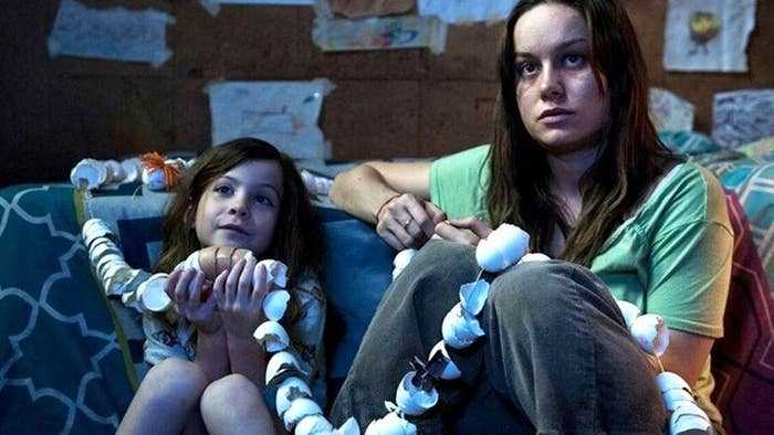 """Room is about a woman (Brie Larson) and her son (Jacob Trembley) who has been held captive for seven years by a man they call """"Old Nick."""" Larson's character was abducted by """"Old Nick"""" and has been sexually abused by him since her abduction. She however remains optimistic for her son and only allows him to believe that the shed they live in is the world around them. The movie follows their story and how they are finally able to get the freedom they have been vying for for years."""