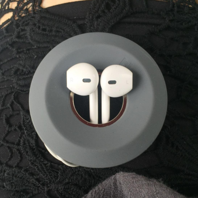 """Promising review: """"I really, really love this little cable ring thing! My headphones were always such a pain to untangle at the gym. Now, I keep them in this holder and clipped to my water bottle, so I can grab both as I'm getting out of the car and be on the treadmill with my music on in no time!"""" —Michelle Get it from Amazon for $9.95 (available in three colors)."""
