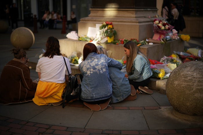 Teenage girls singing Ariana Grande songs near floral tributes in Manchester in May to mark the first anniversary of the terror attack.