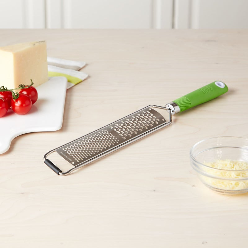 "Promising review: ""This is a beautiful lime green color and the handle is easy to hold. It has a very large grating range, which is nice because you can get your job done fast."" —DROMPGet it from BuzzFeed's Tasty collection for Walmart for $7.97 (originally $8.97; available in four colors)."