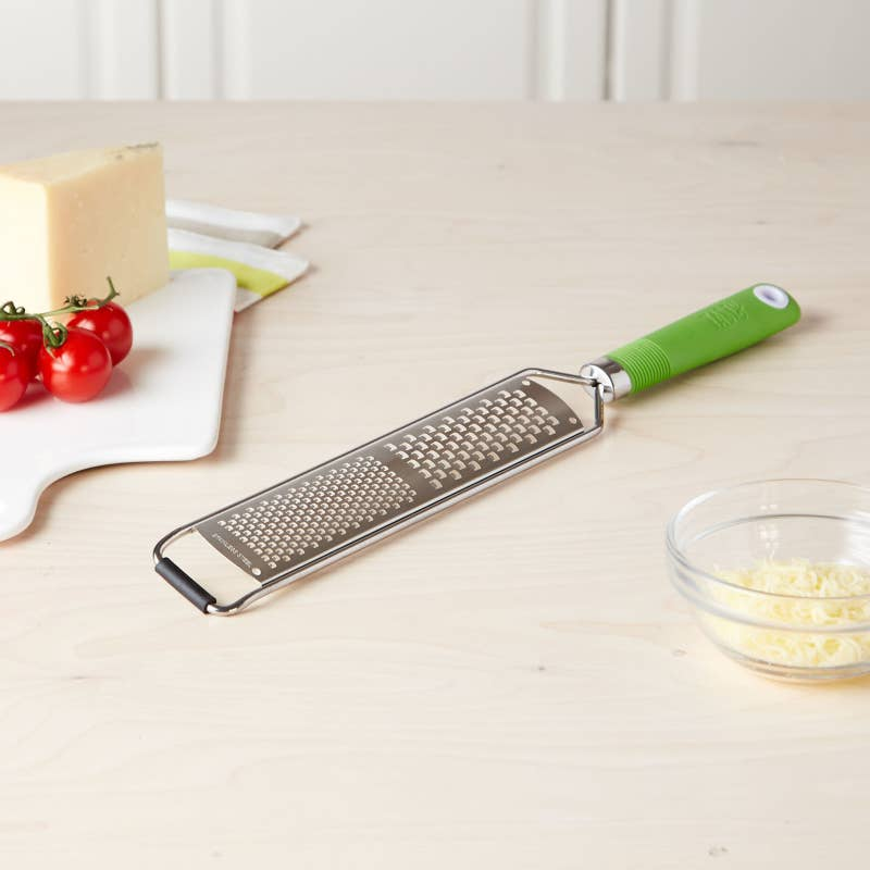 """Promising review: """"This is a beautiful lime green color and the handle is easy to hold. It has a very large grating range, which is nice because you can get your job done fast."""" —DROMPGet it from BuzzFeed's Tasty collection for Walmart for $7.97 (originally $8.97; available in four colors)."""