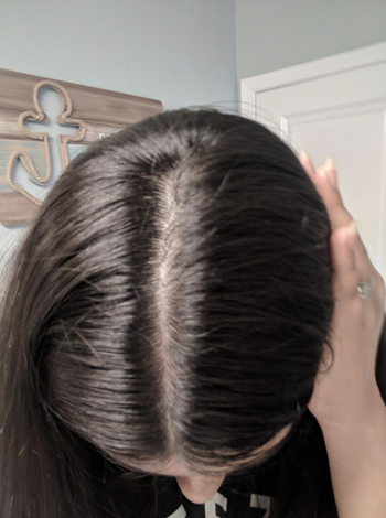a person showing their hair after using the set