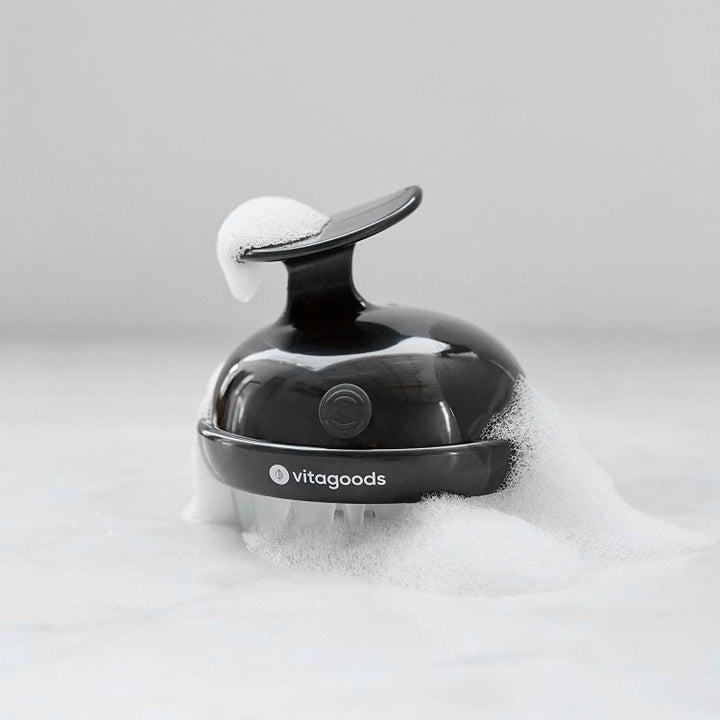 The shampoo brush in black