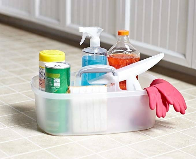 Cleaning caddy with a bunch of cleaning supplies