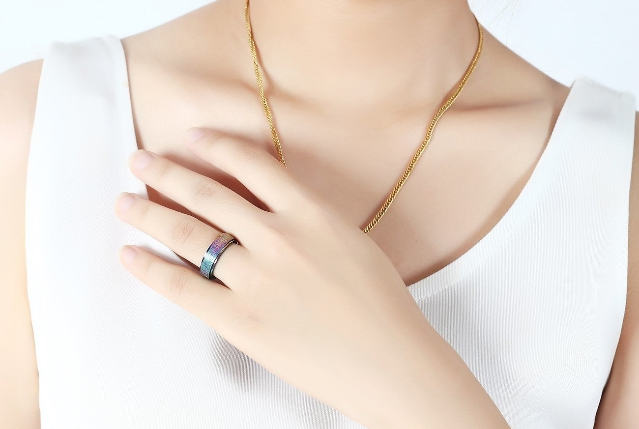 """Promising review: """"I've had this ring for about two weeks now and just had to write a review. I've had the nervous/bored habit of picking at my fingers since I was a kid. I can't remember the last time I've not had at least one nail bed torn up and bloody. For people with similar habits, I can't recommend this ring enough. It's a great, non-distracting way to redirect fidgety behaviors. I've worn it every day since receiving it and for the first time in years I have intact nail beds! Every time I catch myself starting to pick at a dry patch of skin or uneven cuticle on my finger, I rotate the ring a few times and the impulse disappears."""" —KGLGet it from Amazon for $7.99 (available in sizes 4-12 and six colors)."""