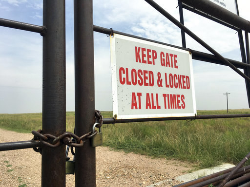 A locked gate at an entrance to a ranch in Colorado's eastern plains, near where police say the bodies were discovered.
