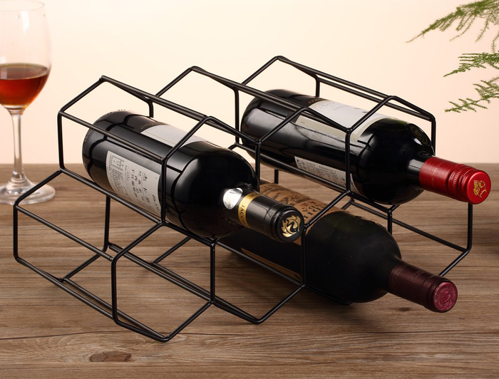 """Promising review: """"Love this wine rack — clean, modern look, lightweight yet high quality for a great price!"""" —rossmanmelissaGet it from Amazon for $36.99+ (available in three finishes)."""