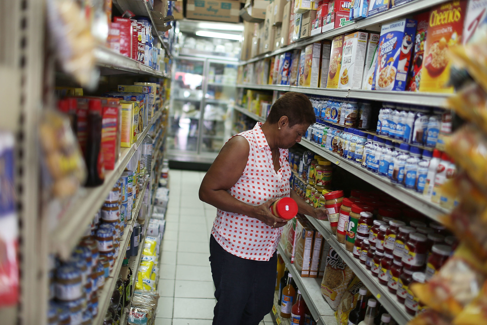 A customer shops for items in a grocery store in San Juan, Puerto Rico.