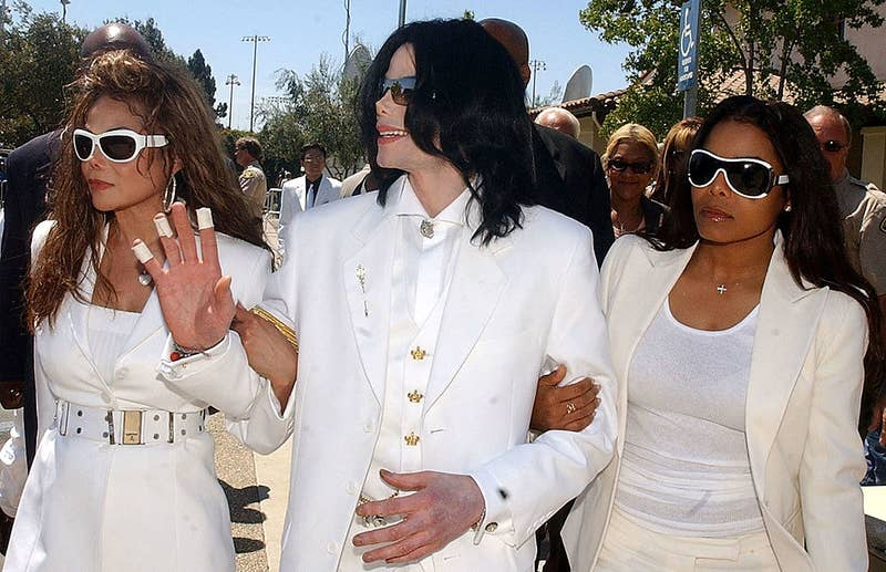 Michael Jackson with sisters LaToya Jackson (left) and Janet Jackson exit the Santa Maria courthouse on Aug. 16, 2004, in Santa Maria, California.