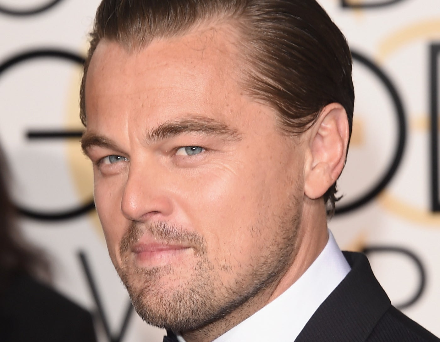 """Leonardo DiCaprio at the 2016 Golden Globes, where he shared his award win with """"all the indigenous communities around the world."""""""