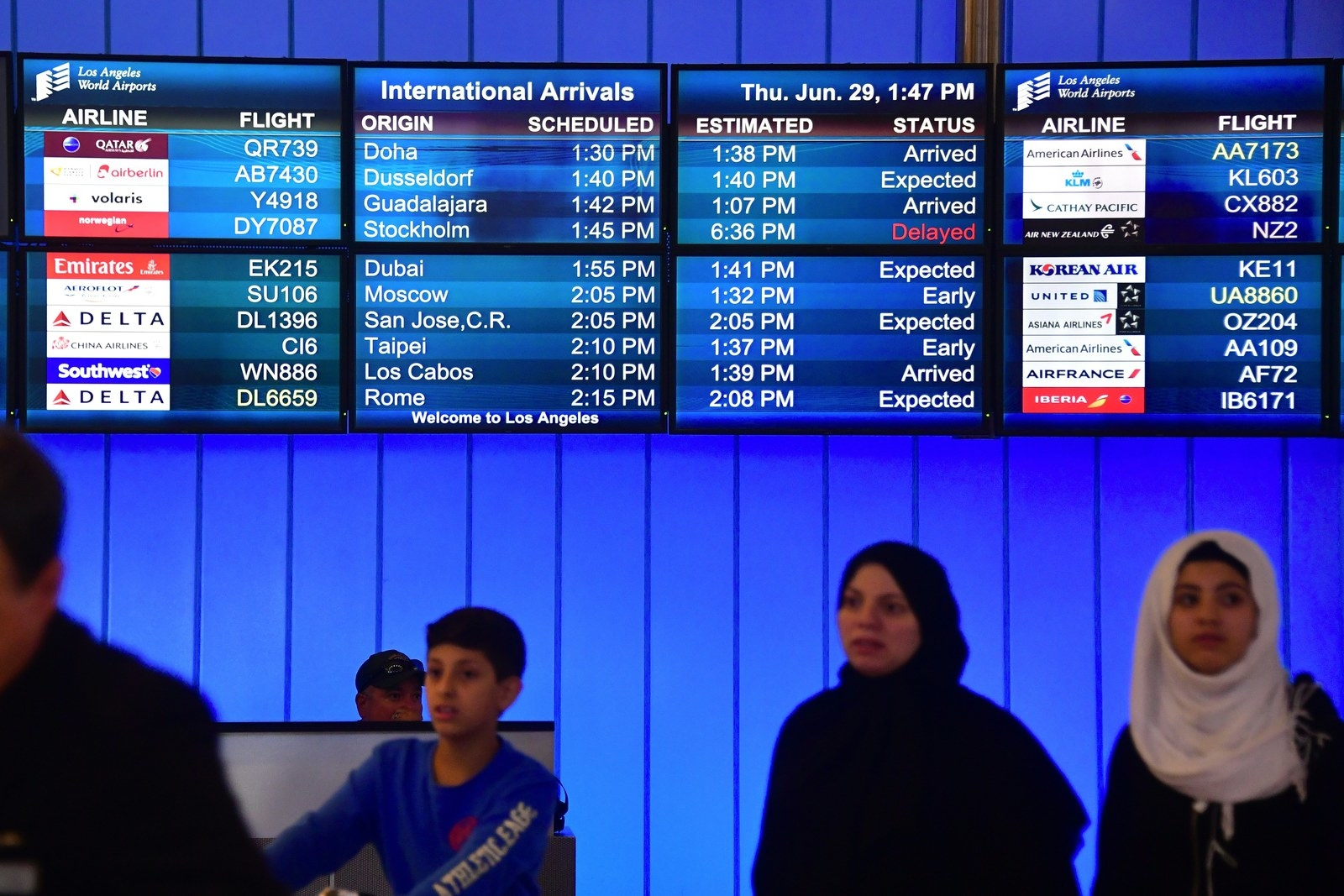 Travellers from the Middle East exit the International Arrivals section at Los Angeles International Airport