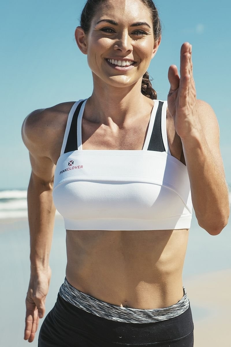 model wearing band over bra while running