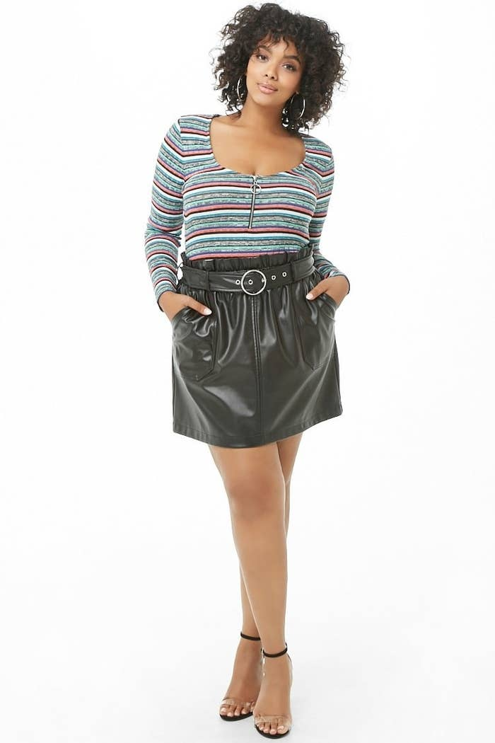 1fcf5aac9bf A faux leather mini skirt with a stretchy waist and removable belt so  you'll look incredibly put together while feeling incredibly comfy. Forever  21