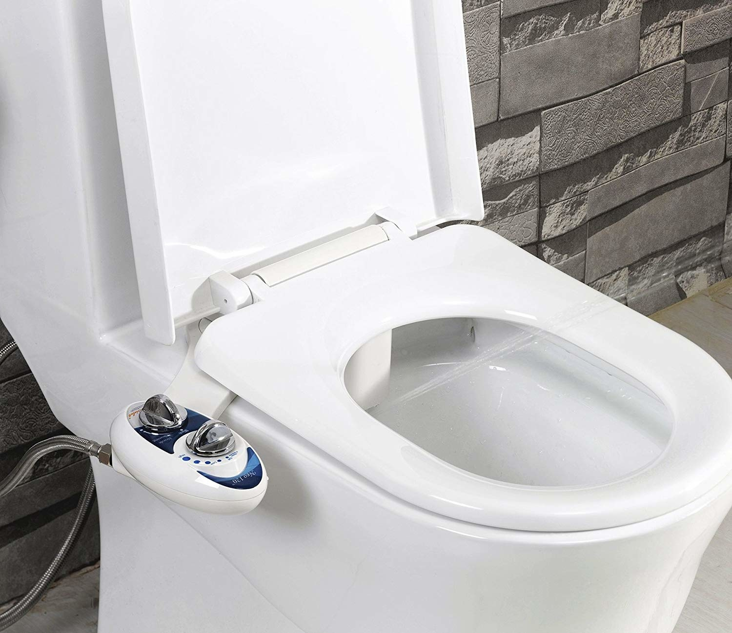 bidet with small dial attached to toilet