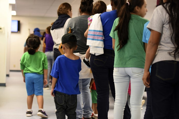 Mothers and their children stand in line at South Texas Family Residential Center in Dilley, Texas.