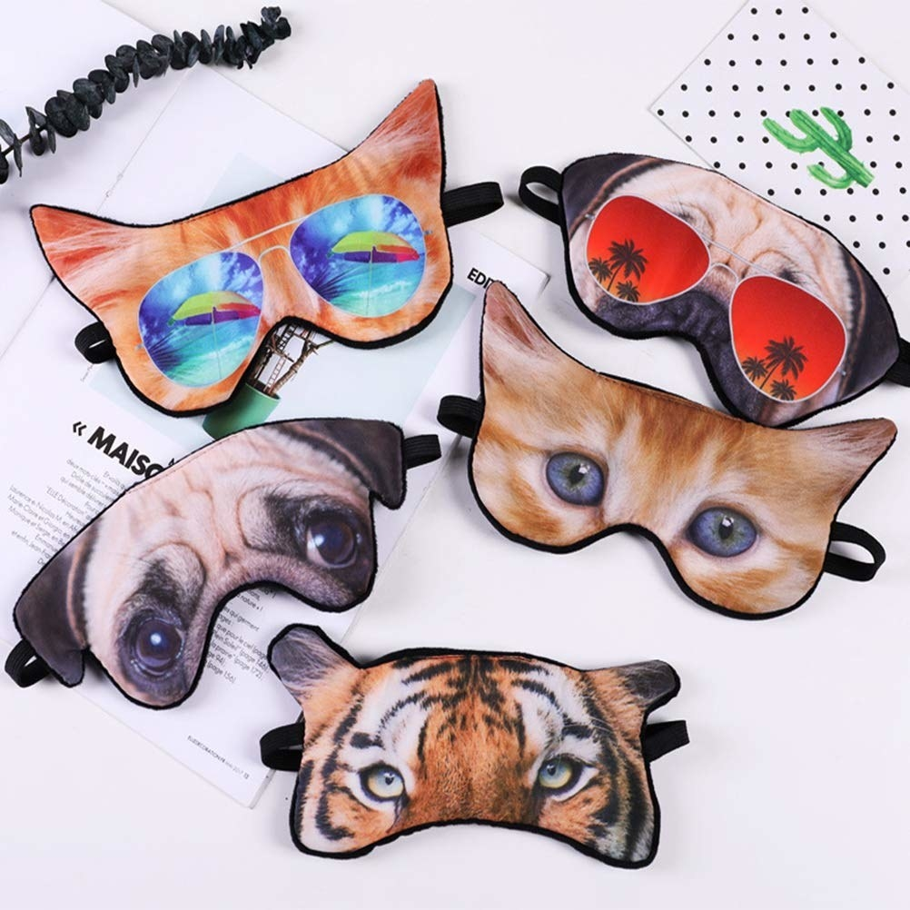 The sleep masks in multiple animal face designs, like pug, tiger, and cat