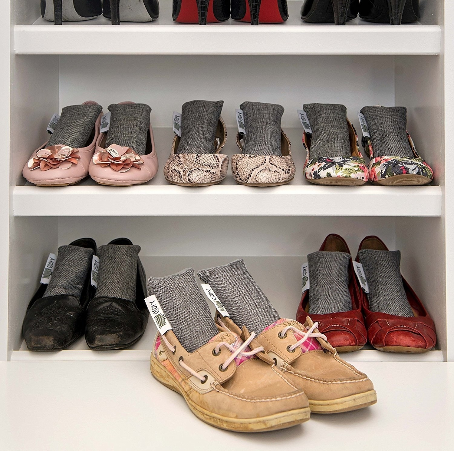 shelves of shoes with deodorizers in them