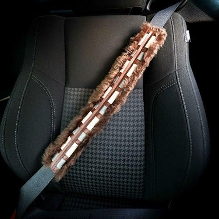 furry seatbelt cover that looks like Chewbacca's sash