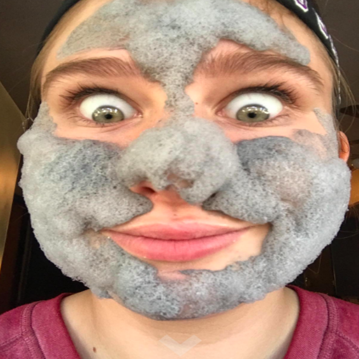 Reviewer wearing the bubbling face mask