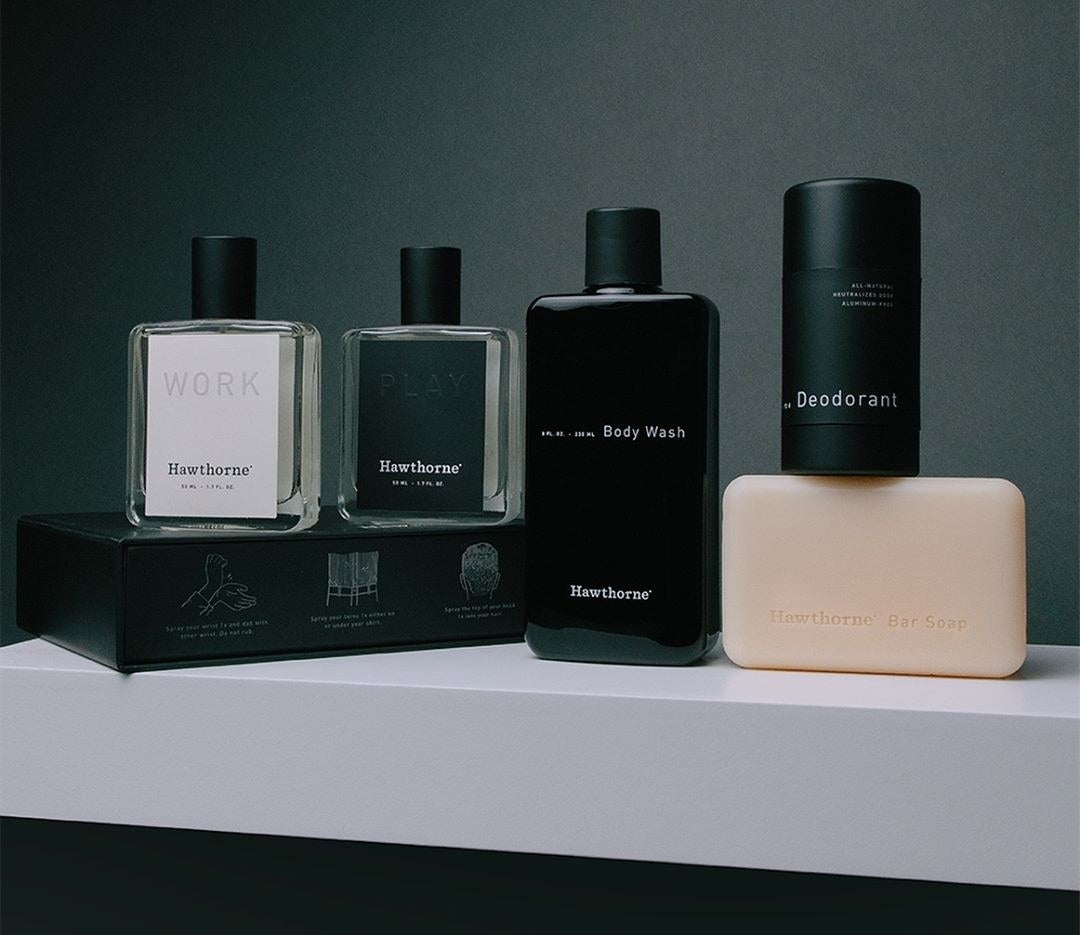 different bottles of cologne, body wash, and deodorant styled together