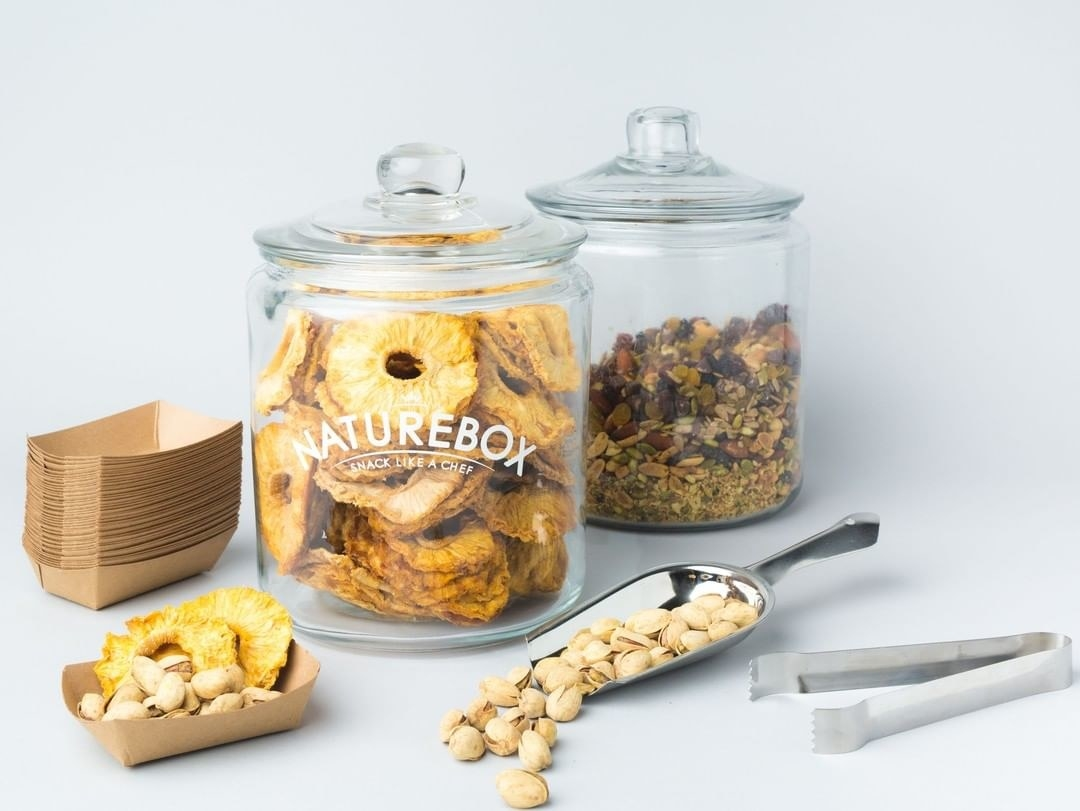 jars of dried fruits and nuts styled on background