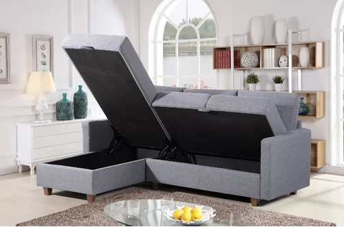 sectional L couch with seat lifted up to show storage inside