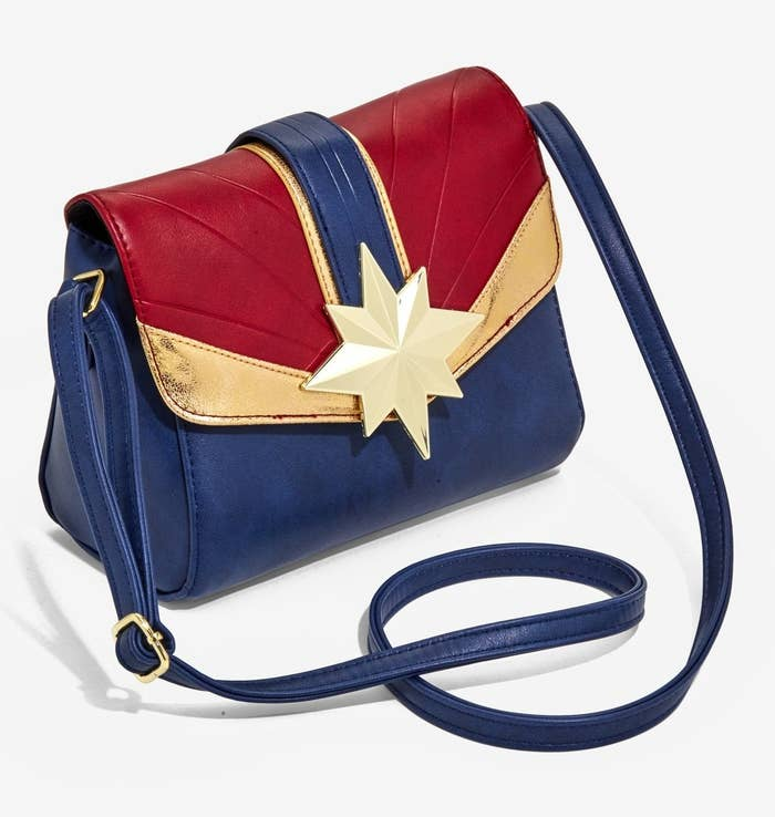 """Promising review: """"It's hard to find a purse that's the right size (they're usually huge bags or barely bigger than a wallet) but this one is perfect. It's a nice quality piece and I get to rep Captain Marvel! Very satisfied with my purchase. I even got a compliment on it the other day."""" —SHNEENGet it from Hot Topic for $39.90."""