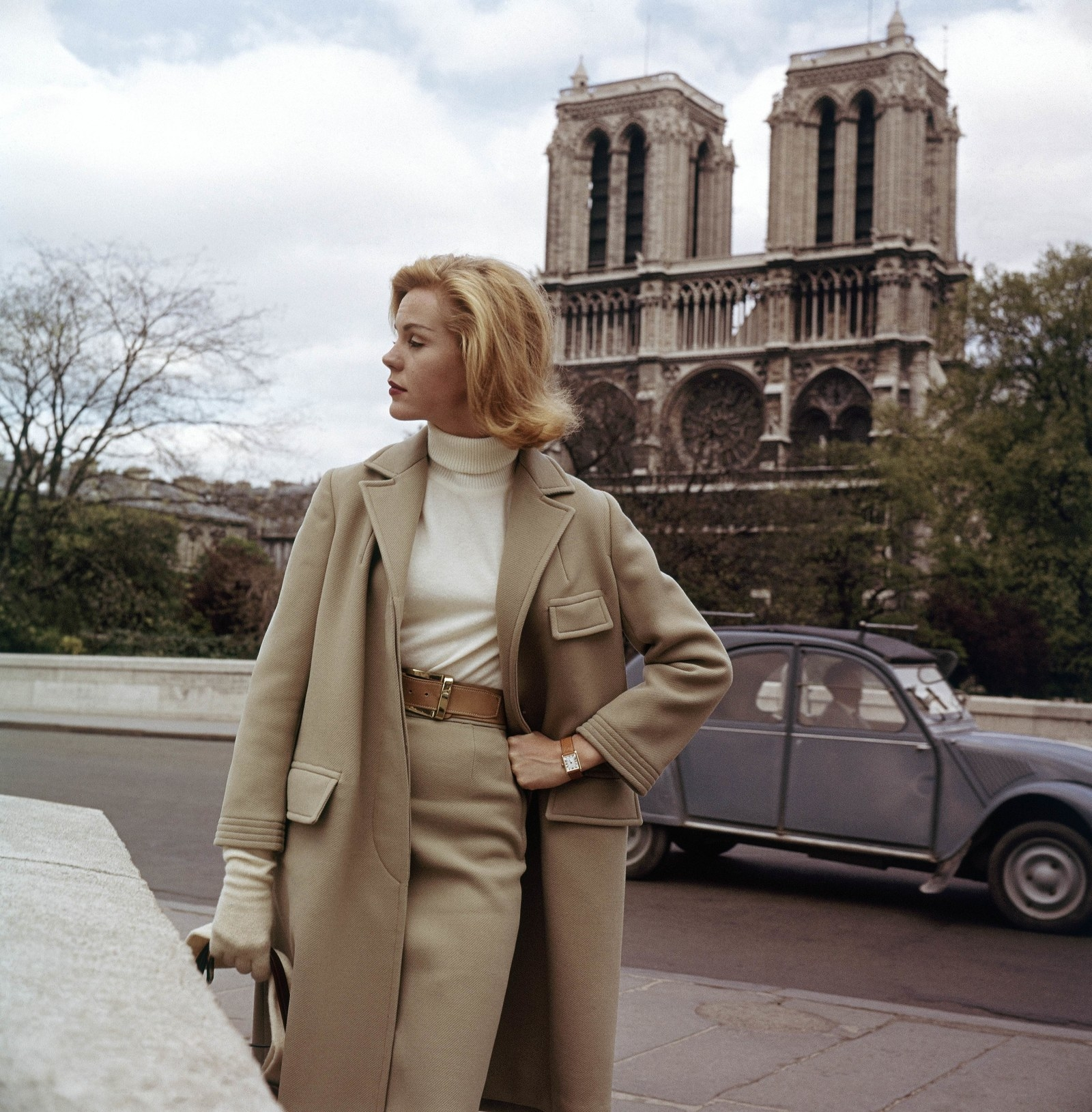 A model poses for a photo in front of Notre Dame Cathedral in 1961.